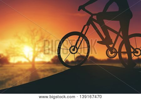 Silhouette Of A Woman On Muontain Bike, Sunset.vintage Color