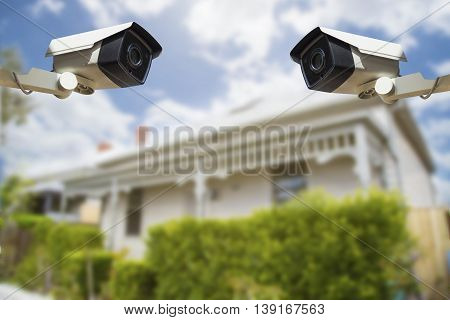 CCTV Security Camera with house in background