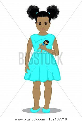 Little girl with a doll in her hand, dressed in a turquoise dress