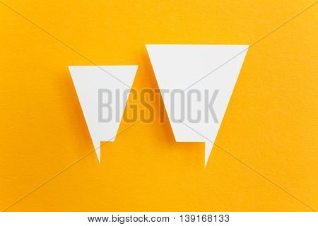 paper speech bubbles on yellow background