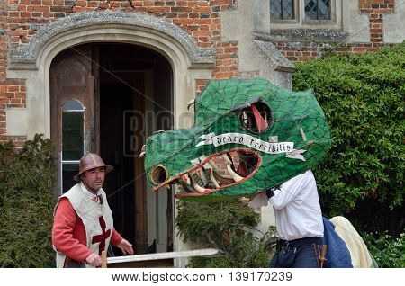 Kentwell Hall England United Kingdom - May 05 2014: Man dressed as Dragon and St George actor in George and the dragon play reenactment