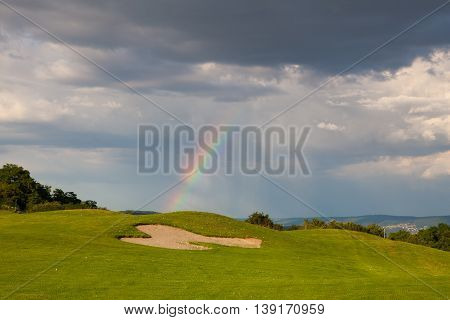Rainbow on the empty driving range after storm