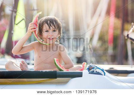 Cute Little Child, Boy, Eating Watermelon On The Beach