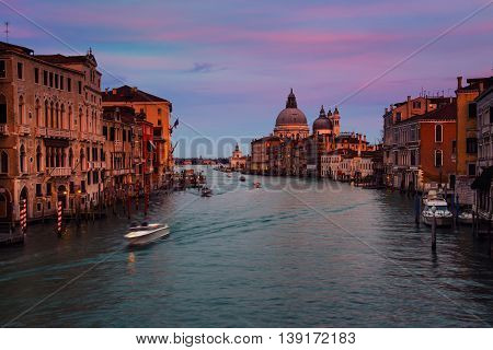 Basilica Santa Maria della Salute - a Roman Catholic church located at Grand Canal in Venice, Italy. It is an emblem of the city and a famous touristic landmark. Sunset sky