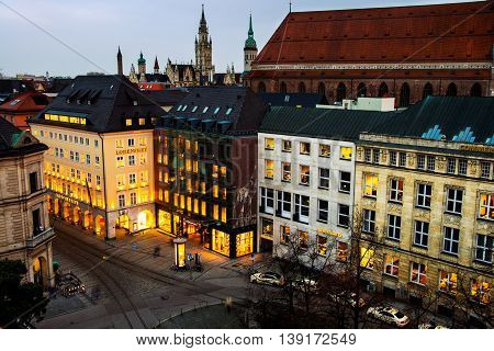 MUNICH, GERMANY - FEBRUARY 22, 2016: Night aerial view of car traffic at Promenade square in city center. Famous buildings with illumination, shops, restaurants and bars. Nightlife