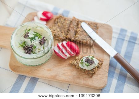 home made whole grain crisp bread with dip