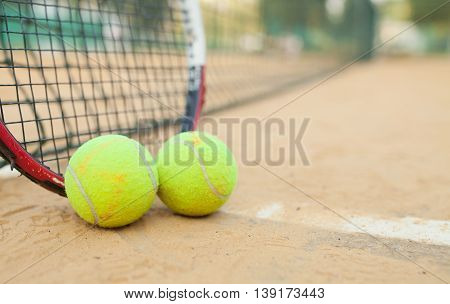 Sport background with a tennis racket and ball.