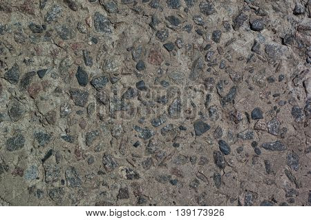 background - part of a concrete wall with granite stones