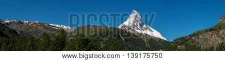 Panorama view of Matterhorn peak in sunny day from Zermatt Switzerland.