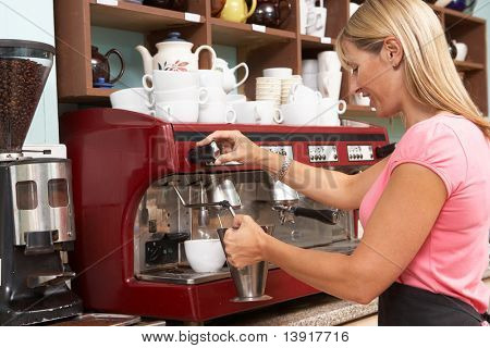 Woman Making Coffee In Cafe