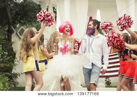 Wedding Couple With Cheerleaders