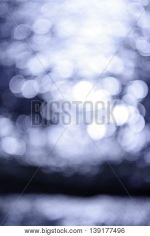 Bokeh Lights on blue sea background. Blurred sea backgrounds