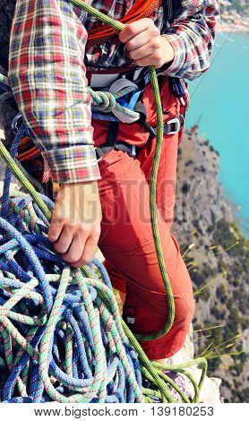 The climber during rock conquest. Climbing sport concept