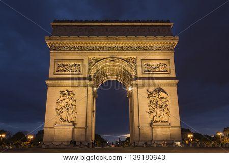 The Arch of Triumph at dusk. Paris France