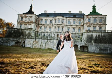 Charming And Fashionable Wedding Couple In Love Background Old Vintage Castle