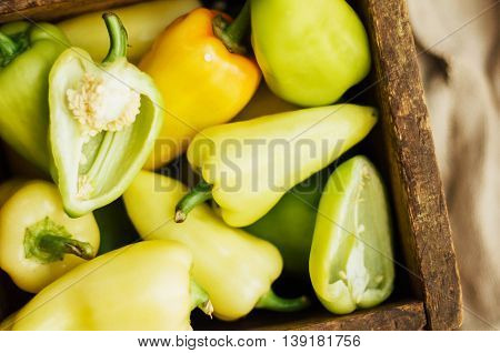 Red Papper On Wooden Table ,selective Focus On Green Part. Background With Peppers