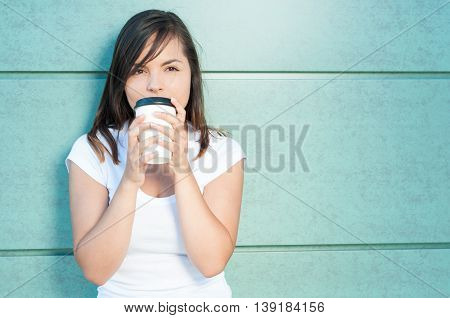 Girl Sipping Fresh Coffee And Being Dreamy
