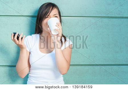 Young Pretty Girl Drinking From Takeaway Coffee Mug