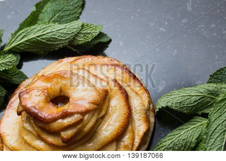 Tart With Apple. Traditional French Pie With Fruits On Dark Marble Background. Decorated Almonds And