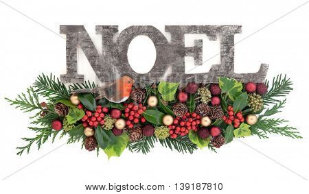 Christmas decoration with old wooden noel sign with a robin and red gold bauble decorations, holly, ivy, pine cones, cedar cypress and fir leaf sprigs over white background.