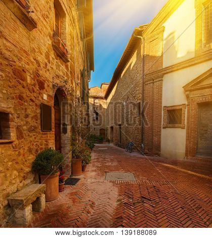 View of the ancient old european city. Street of Pienza, Italy. Sunny travel vintage background with copy space.