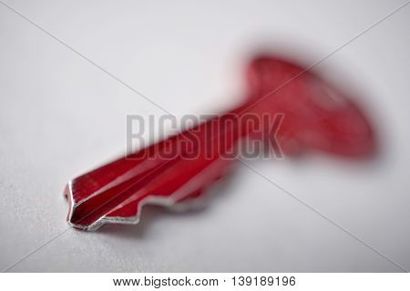 Macro detail of a sharp tip of isolated red metal key