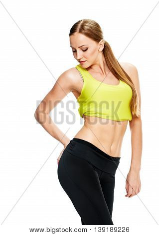 picture of sporty woman checking her hips