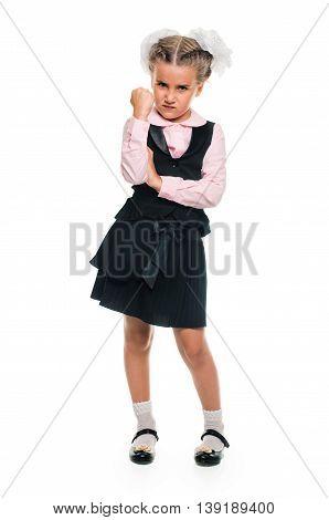 little Schoolgirl threatens with her fist. full length