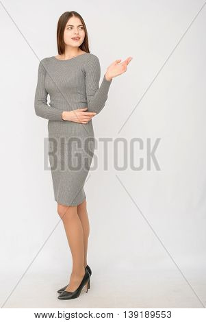Advertisment. Young succesful businesswoman.Woman in dress show copyspace