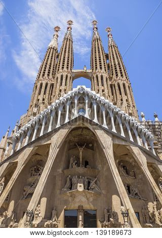 BARCELONA SPAIN - JULY 5 2016: La Sagrada Familia - the impressive cathedral designed by Gaudi which is being build since 19 March 1882 and is not finished yet.