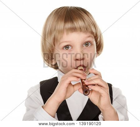 Cute little boy playing wood fife. Preschooler. on white background