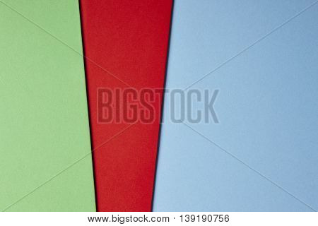 Colored cardboards background in green red blue tone. Copy space. Horizontal
