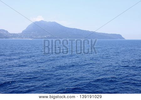 View of the island of Capri from the Tyrrhenian Sea in clear weather. Campania, Italy.