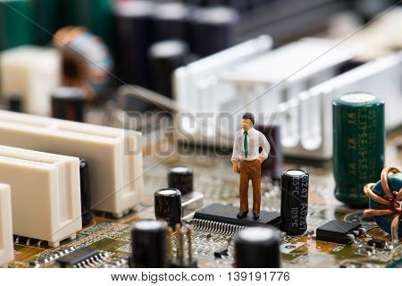 Computer Motherboard And Miniature Person