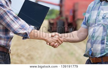 Shaking Hands On Farmland