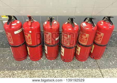 Bangkok Thailand , 19 July 2016 : Fire extinguishers on the floor for fire protection system in factory area safety.