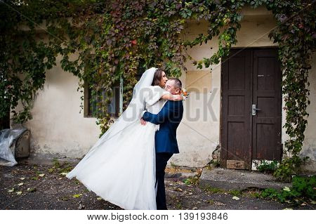 Wedding Couple Background Facade Of An Old Apartment Building Almost Covered With Ivy