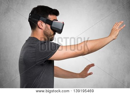 Young man using a VR headset and experiencing virtual reality