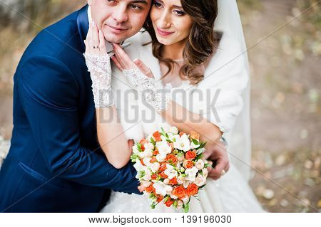 Close Up Wedding Portrait Of Couple In Love