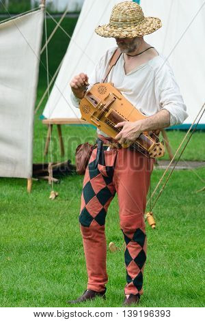 KENTWELL HALL SUFFOLK UK - May 05, 2014: Medieval minstrel playing hurdy gurdy
