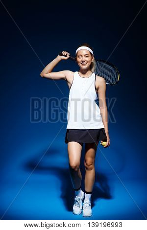 Picture of young fintess girl holding tennis racket