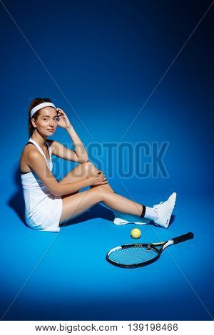 Picture of young fintess girl near tennis racket