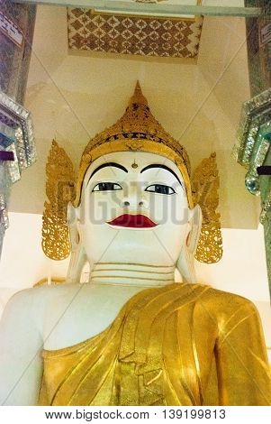 A Huge Statue Of A Sitting Bubba In The Interior Of The Temple. Pagoda. Amarapura, Myanmar. Burma.