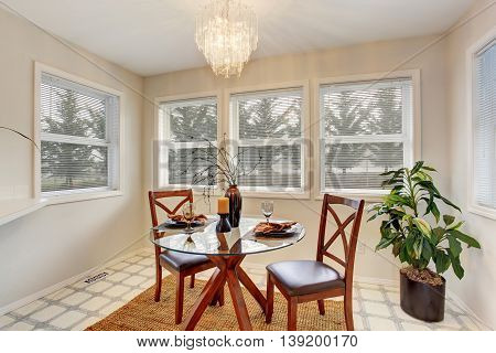 Dining Area With Glass Table And Windows Around