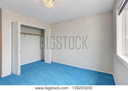 Empty Luxury Room Interior With Blue Carpet Floor And Chandelier