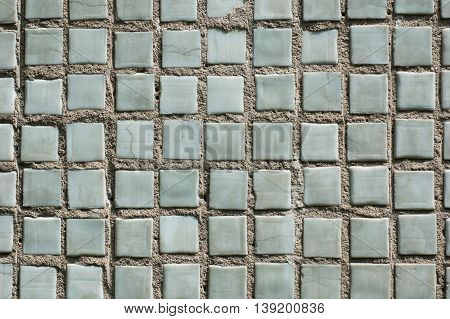 background - gray tiles laid flat on the cement