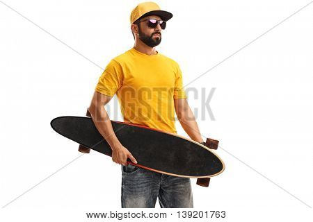 Studio shot of a skater guy holding a longboard isolated on white background