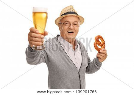 Mature man holding a pint of beer and a pretzel isolated on white background