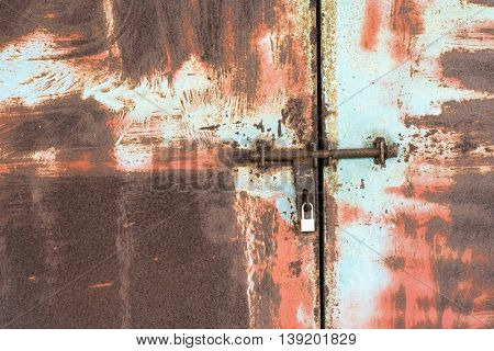 Closeup metal door with lock in grungy style and good texture