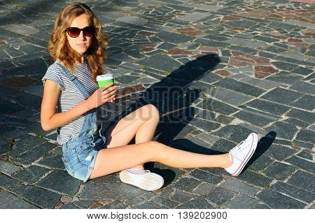 Fashion Hipster Style Of Blonde Woman With A Disposable Coffee Cup